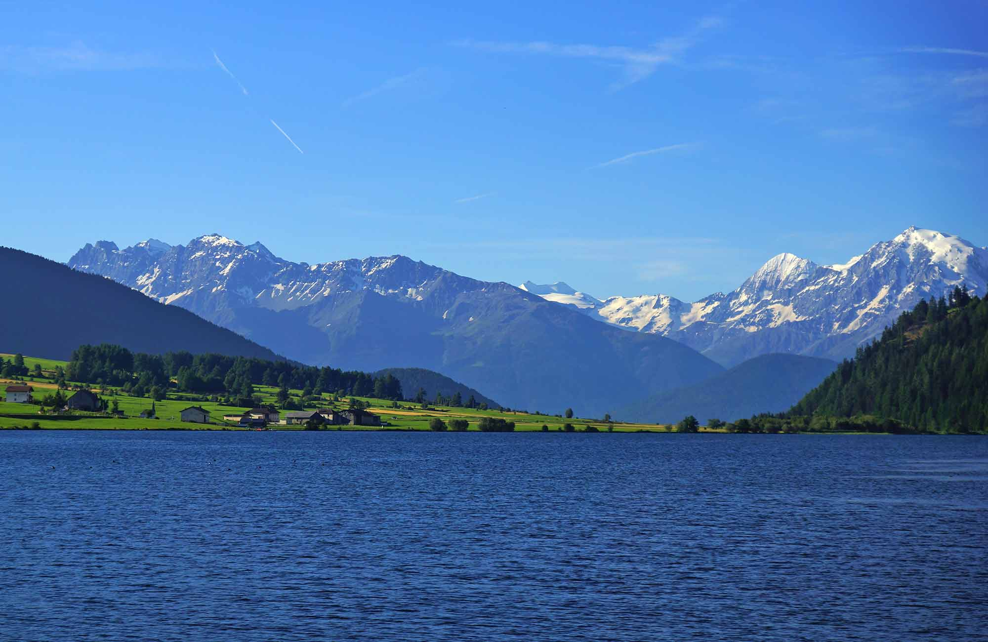 Lake Haidersee in the Obervinschgau with view of the Ortler